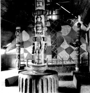 "Carved pillars in Obu house Abiriba. Jones notes: 'Figures carved on the central pillar are: below, a woman with a waterpot on her head; above, an ""Egbo runner"" (i.e. the agent of the Ekpe [Egbo] secret society, his identity concealed beneath a tight fitting all enveloping costume and believed by the uninitiated to be a forest daemon. The servant of the Ekpe spirit to which the society ministers.)"