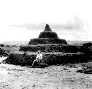 Jones posing in front of a pyramid Nsude village shrine, Abaja, Northern Igbo