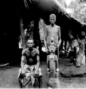 "Alusi The same shrine with its priest (seated) and it's osu (""juju slave""), Orsu, West Isuama Igbo"