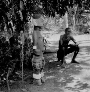 Alusi With its priest and its  ritual iron belled staff, Orsu, West Isuama Igbo